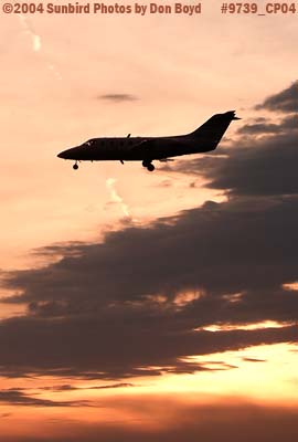 Flight Options LLCs (Richmond Heights, OH) Beech Beechjet 400A N431CW landing at sunset corporate aviation stock photo #9739