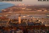 Charlotte Douglas International Airport at sunset with downtown Charlotte in the background aviation stock photo #9703