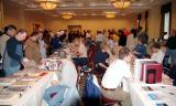 Customers and vendors in the large room at the 2005 Boston Airline Show, photo #7226