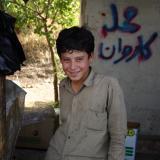 boy in roadside shop