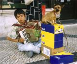 Boy with dog performing for escudos.jpg