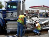 Truck hits Semi - spilling 150 gallons of fuel