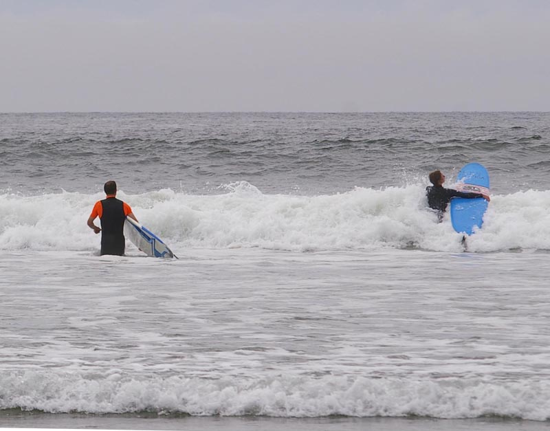 Gord and Hana getting out to waves