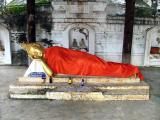 Sleeping Buddha and Red Bull Offerings