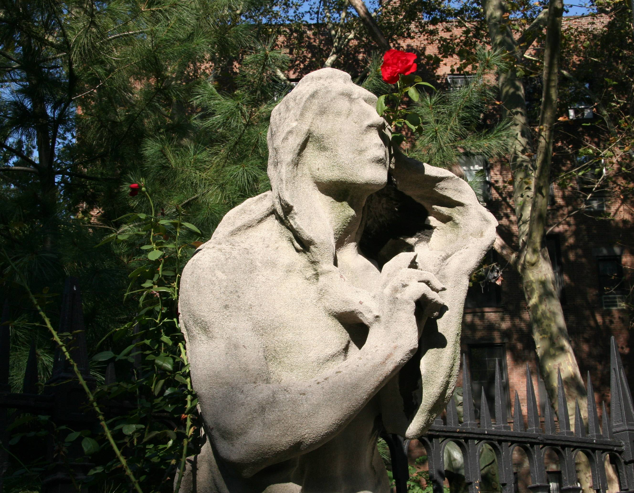Indian Smelling a Rose - St Marks Churchyard