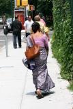 Strolling on LaGuardia Place Sidewalk