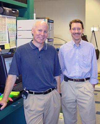 Drs. Heinrich and Corless in their lab. at OHSU
