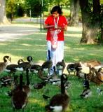 Lady feeding the ducks
