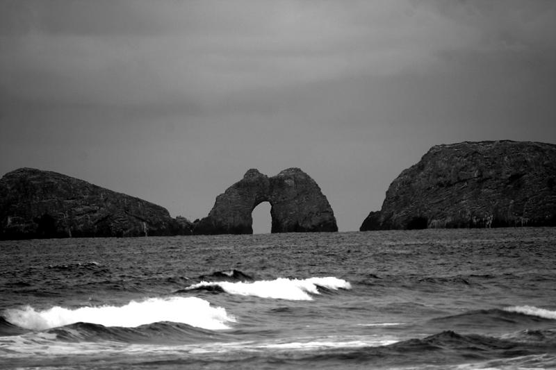 Oregon Coast Haystacks with keyhole black and white.jpg