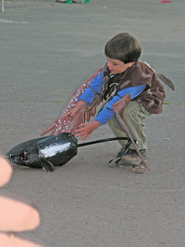 Boy chasing mouse