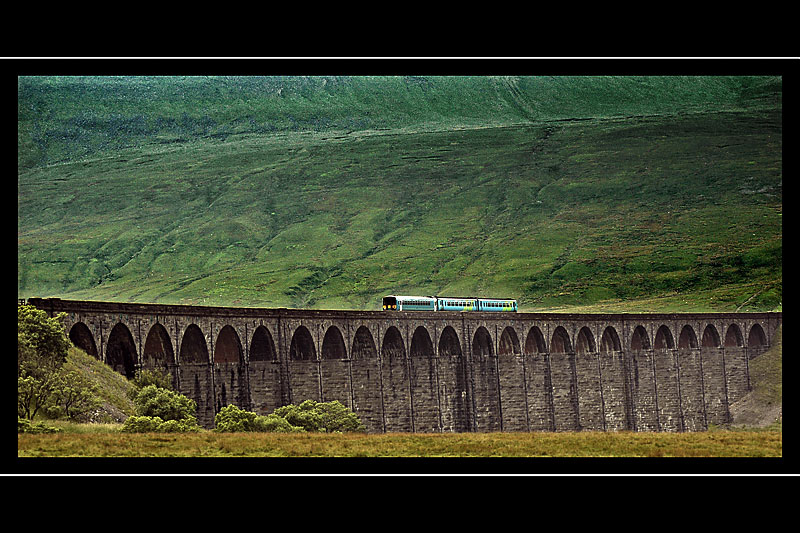 A train crosses the Ribblehead Viaduct, Yorkshire Dales