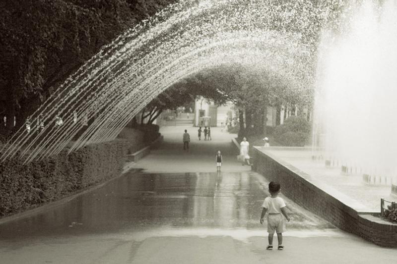 boy under water curtain at Grand Childrens Park, Seoul (James Hendrick)