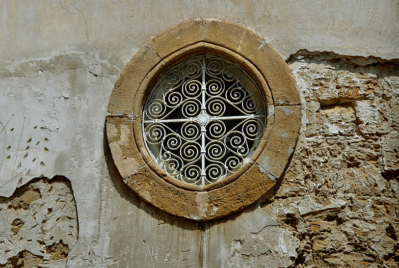 War-torn window