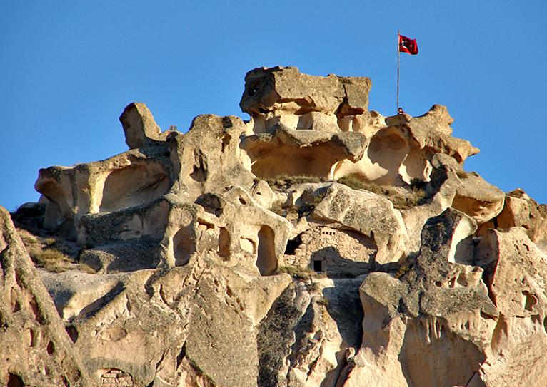Uçhisar castle detail at sunset