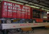 Ringling Bros. & Barnum & Bailey baggage wagon and cage wagon on flat car. ca 1950.