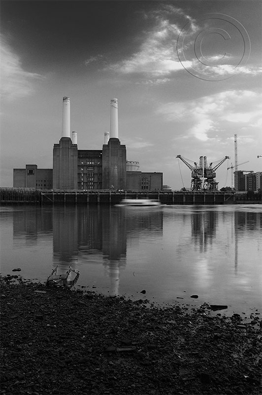 A view from the bed of the Thames at low tide of the power station