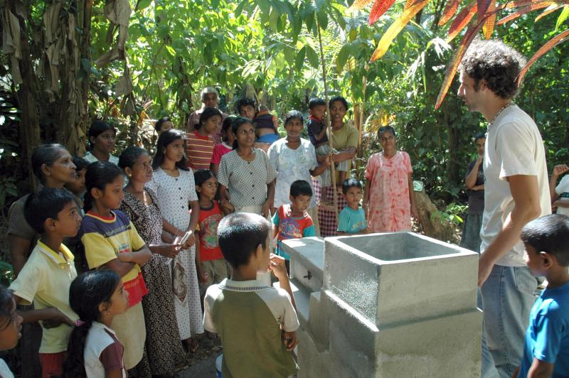 A community gathering is held to discuss correct use of  UV Tube, safe water storage, and hygiene
