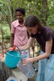 A water quality sample is taken from a drinking well