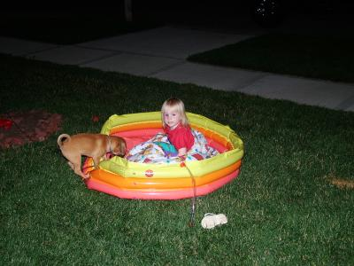 Lexi in pool with buddy