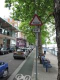Flood warning sign. Embankment. Star and Garter to left.