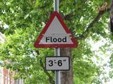 Flood warning sign close up.