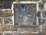 Flood level sign, at top of slipway beside Putney Bridge.