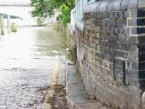 Flood level sign, river level in photo is at the top of a spring high tide.