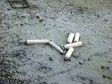 More rubbish (gas cylinders) dumped in the river.