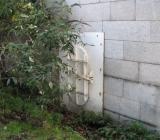 Unusual door in footings to Putney Bridge.