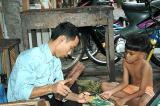 Phnom Penh, Father and son, making souvenirs