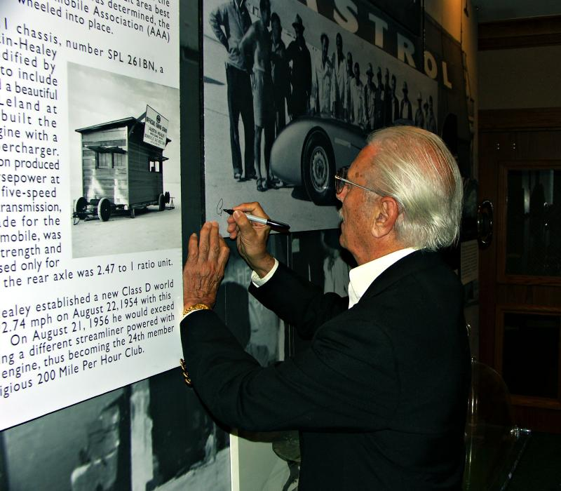 Gerry Coker signing display