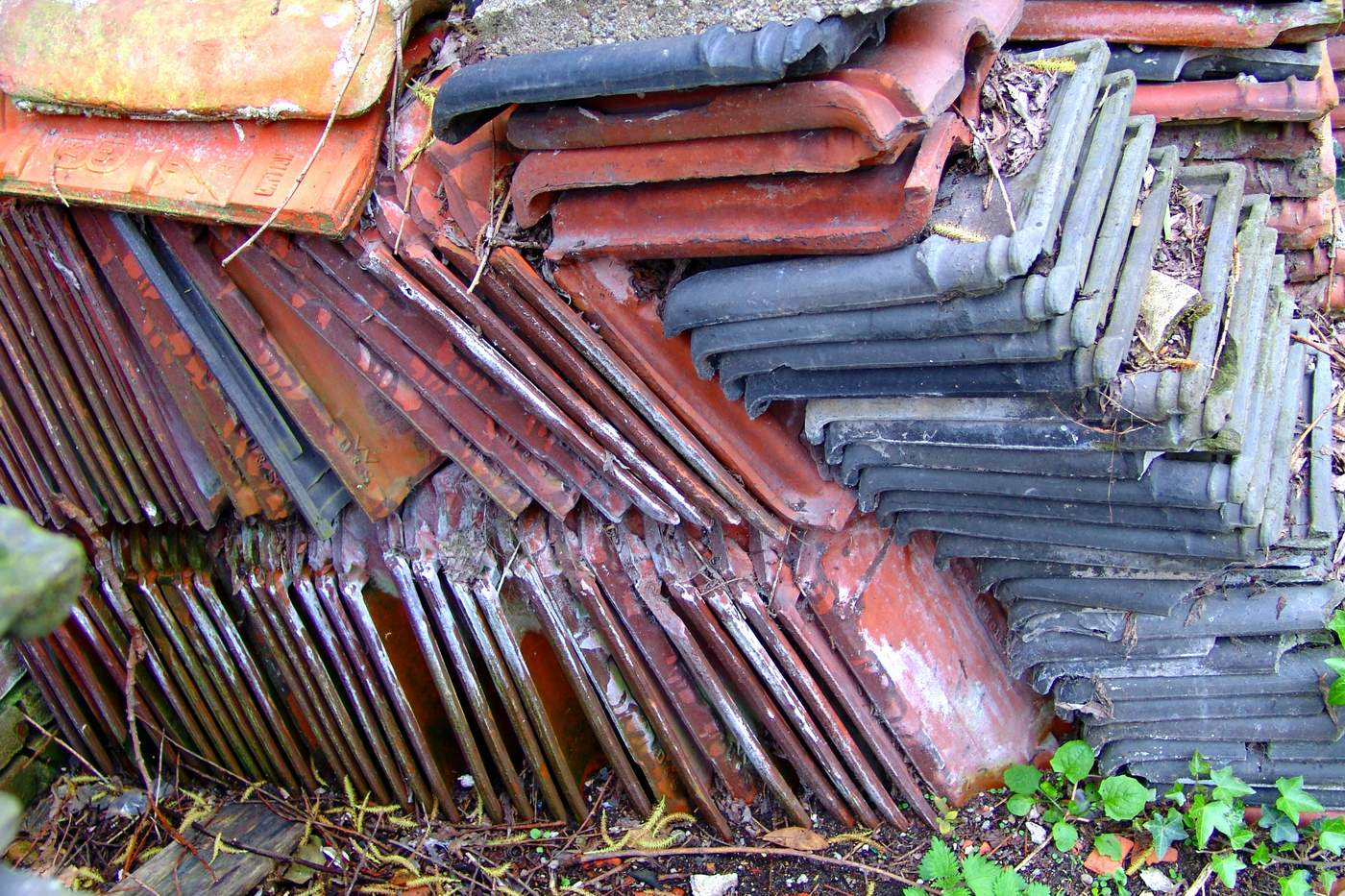A chaotic pile of coloured roofing-tiles