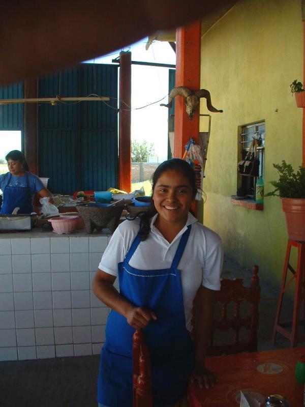 Señorita with smile and pencil.