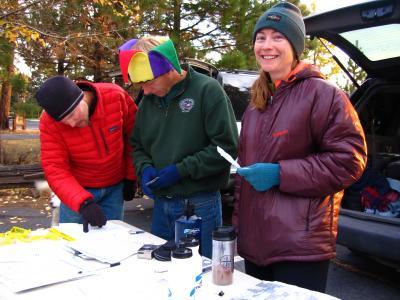 Sean, Gene & Kristin checking people in