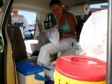 Maggie & Leah organizing the vans