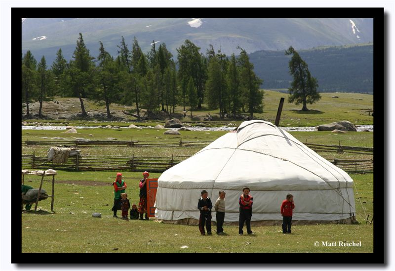 A Kazakh Family Gathering Outside their Ger, Altai Tavanbogd National Park