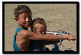 Brother and Sister Riding a Bike in the North Gobi Desert