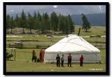 A Kazakh Family Gathering Outside their Ger, Altai Tavanbogd National Park