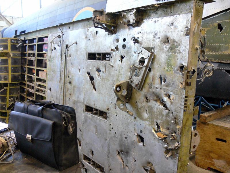 AVRO Lancaster Mk X Bomber undergoing restoration. Note the shrapnel damage