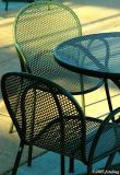 Chairs on sunlit deck