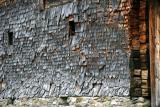 Mur en tavaillons sur un chalet traditionnel