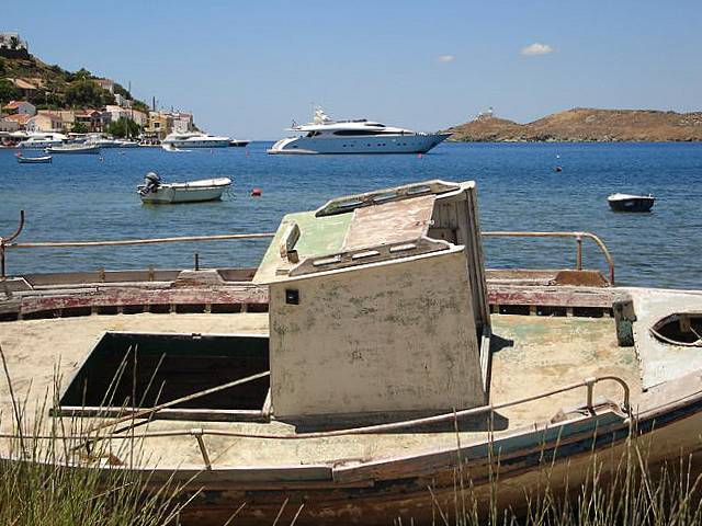 Veteran fishing boat, glamorous yacht