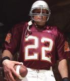 football player helmet wearing jersey