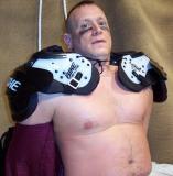 football player locker room removing shirt