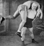 classic vintage pro wrestling carrying man