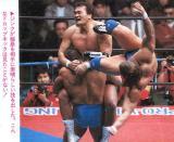 dropkick men kicking opponents wrestling