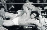 wrestler being thrown to canvass
