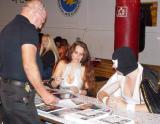 masked wrestlers signing autographs