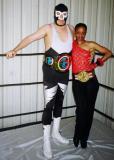black women wrestler posing with man