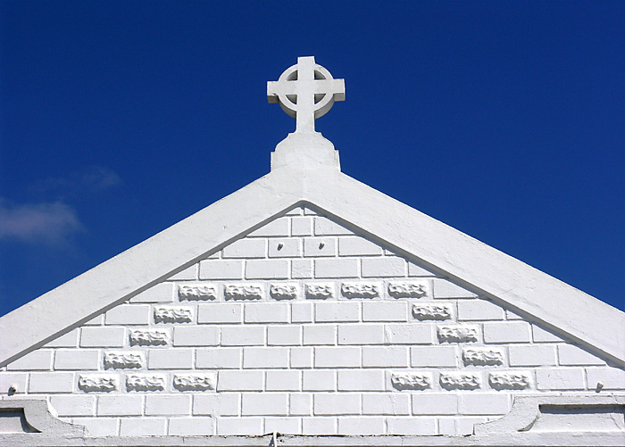 Cross on white wall